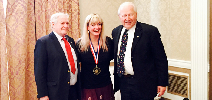 Jen Reeder with one of her Maxwell Medallion Awards